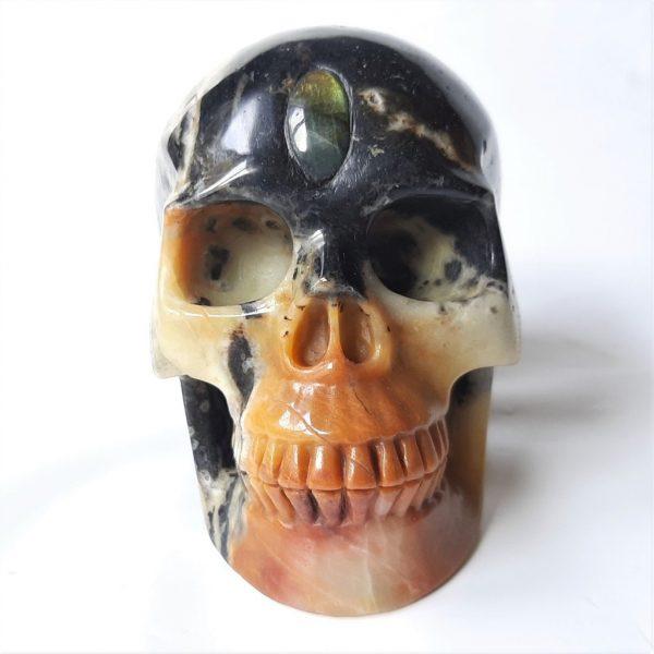Deze Chinese amazonietschedel is9.5 cm hoog en weegt 1235 gram.